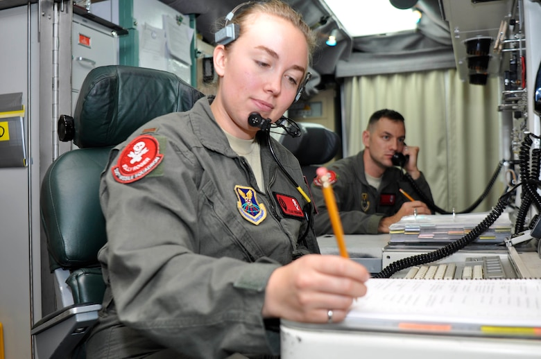 Second Lieutenant Teah Heidorn, 320th Missile Squadron deputy combat crew commander, writes notes during a Simulated Electronic Launch-Minuteman test inside a launch control center at a missile alert facility in the 90th Missile Wing missile complex, Aug. 21, 2018. Accomplishing the SELM validates these claims and increases the deterrent capability of the Minuteman III ICBM weapon system. (U.S. Air Force photo by Senior Airman Breanna Carter)