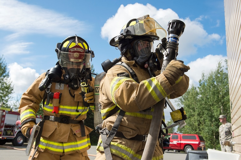 Air Force fire protection specialists conduct wartime-firefighting readiness training at JBER.