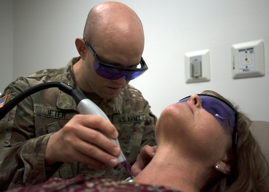 U.S. Army Capt. Jonathan Jeter, 59th Medical Wing dermatology resident, conducts a pulse dye laser treatment on a patient at the Wilford Hall Ambulatory Surgical Center, Joint Base San Antonio-Lackland, Texas. The PDL is used to reduce skin blemishes and scars. The dermatology clinic provides care to approximately 33,000 patients a year. (U.S. Air Force photo by Staff Sgt. Kevin Iinuma)