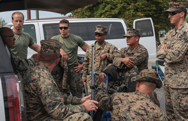 Marines with the Marine Corps Recruit Depot Parris Island Shooting Team, discuss their plan of attack before the Infantry Trophy Team Match at Camp Perry, Ohio August 2, 2018. The National Trophy Rifle Matches are an annual sporting festival established by congress and President Roosevelt in 1903.