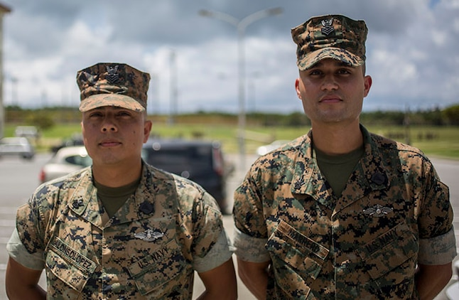 Hospital Corpsmen First Class Jose Marrero Dejesus and Ricardo Alonsolopez, with 2nd Battalion, 3rd Marines, standby before being awarded the Navy and Marine Corps Achievement Medal on Camp Hansen, Okinawa, Japan, July 13, 2018. They were on their way to get breakfast when they noticed a Marine showing signs of distress while running the physical fitness test. Marrero and AlonsoLopez conducted medical care to the distressed Marine which resulted in saving that Marine's life. (U.S. Marine Corps photo by Lance Cpl. Marcus Allen)