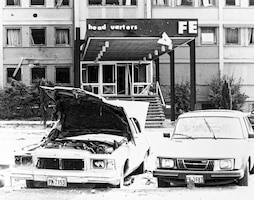 Blown out windows, damaged care and the torn up entrance to the US Air Force Europe headquarters, as well as damaged cars, the result of a bombing at Ramstein Air Base by the Red Army terrorist group, on August 31, 1981. Air Force dentists treated 15 people wounded in the attack. (U.S. Air Force photo)