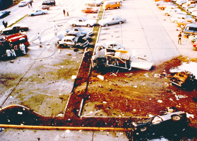 The explosion site in the parking lot of the U.S. Air Forces in Europe headquarters building at Ramstein Air Base where, on August 31, 1981, the Red Army terrorist group detonated two care bombs. Air Force dentists treated 15 people wounded in the attack. (U.S. Air Force photo)