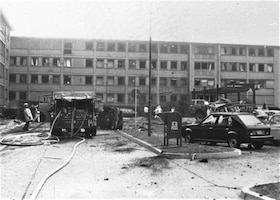 Emergency personnel respond to a terrorist bombing at US Air Force Europe headquarters on Ramstein Air Base, August 31, 1981. Air Force dental personnel from the base dental clinic located across the street from the bombing site treated the 15 people wounded in the attack. (U.S. Air Force photo)