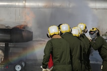 Marines conduct shipboard firefighting drills in Cherry Point, North Carolina to prepare for upcoming deployment.
