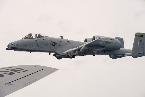 An A-10 Warthog flown by Lt. Col. Curt Martin, a pilot from the 122nd Fighter Wing, Fort Wayne, Ind., flies off the wing of a KC-135R Stratotanker from the 434th Air Refueling Wing at Grissom, Ind. during an Indiana Employer Support of the Guard and Reserve event Aug. 24, 2018. More than 60 people, nominated by Guard and Reserve members from the 434th ARW, the 122th FW, and the 181st Intelligence Wing in Terre Haute Ind., had a hands-on tour of the base that concluded with an air refueling mission. (U.S. Air Force Photo/Staff Sgt. Christopher Massey)