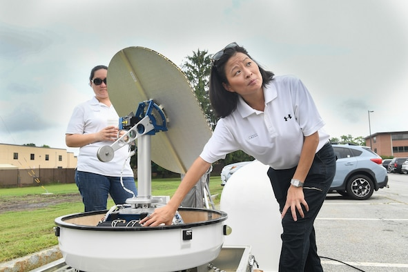 Margaret Williams, right, vice president of EWR Radar Inc., speaks to base personnel about the doppler radar system installed Aug. 14 at the Hanscom Air Force Base, Mass., weather engineering facility while Rebecca Williams, EWR contract administrator, looks on. (U.S. Air Force photo by Todd Maki)