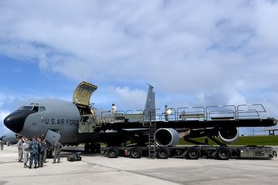 Airmen unload cargo from an Air Force KC-135 Stratotanker.