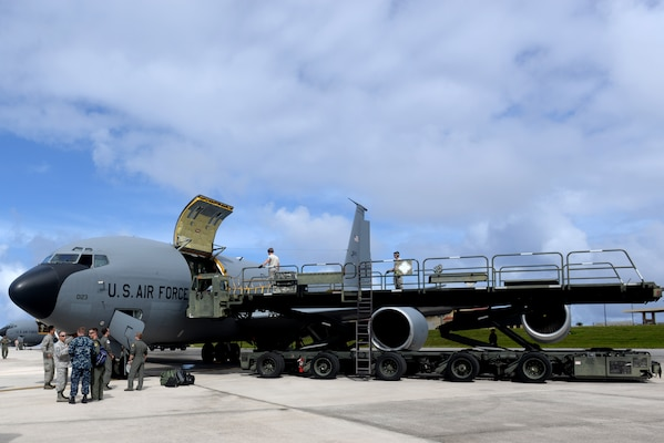 Airmen unload cargo from an Air Force KC-135 Stratotanker.