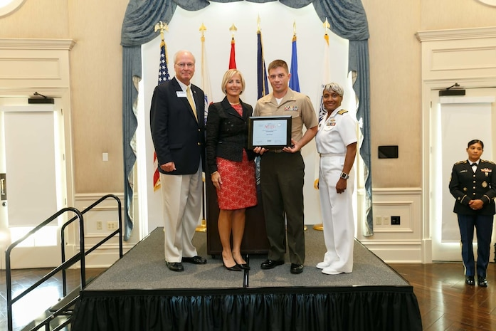 Maj. Samuel Johnson, second from left, executive officer, 3rd Battalion, 14th Marine Regiment, 4th Marine Division, presents the Secretary of Defense Employer Support Freedom Award to his civilian employer Duke Energy at the Pentagon, Aug. 24, 2018. The Freedom award is presented annually to the nation's 15 most supportive employers who have demonstrated exceptional support. It is the highest recognition given by the U.S. government to civilian employers for their support of employees who serve in the Reserve or National Guard. (Courtesy photo)