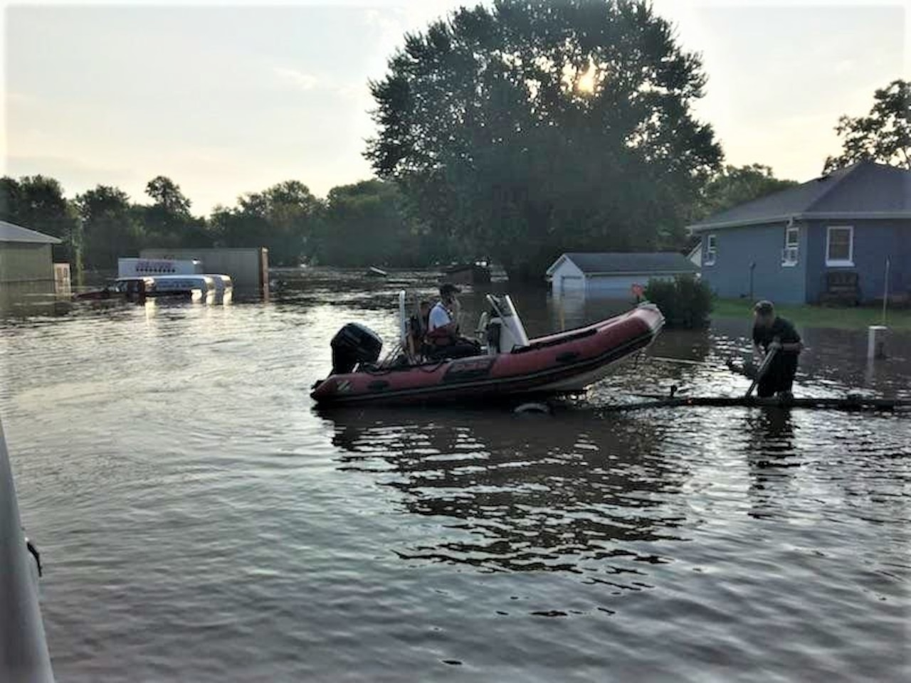 Firefighters prepare to launch a boat for a rescue operation.