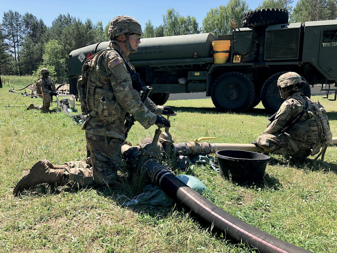 Soldiers with the 240th Composite Supply Company monitor a fuel pump pushing DLA-managed gas in Drawsko Pomorskie, Poland, during Saber Strike 2018. DLA supported the U.S. Army Europe-led exercise in Estonia, Latvia, Lithuania and Poland.