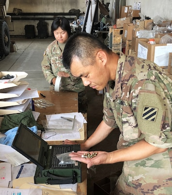 A soldier with the 26th Composite Supply Command counts parts provided by DLA during Saber Strike 2018 in Powidz, Poland. DLA is supporting the U.S. Army Europe-led exercise taking place in Estonia, Latvia, Lithuania and Poland.