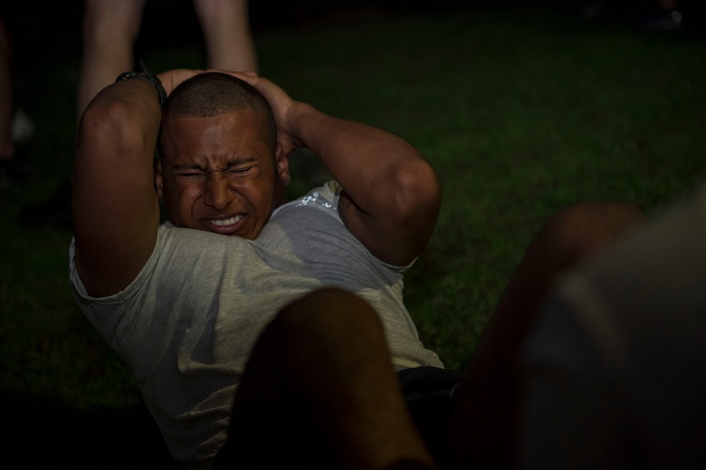 Airman 1st Class Jonathan Webster, 9th Air Support Operations Squadron Tactical Air Control Party specialist, from Fort Hood, Texas, performs sit ups during a Pre-Ranger Assessment Course, Aug. 24, 2018, at Moody Air Force Base, Ga. Moody's 93d Air Ground Operations Wing hosted the three-day assessment which challenged approximately 20 Airmen from the 93d AGOW and 23d Wing on their physical fitness, land navigation skills, leadership qualities, water confidence and academic and tactical abilities under duress. The evaluation is designed to determine whether Airmen are ready to attend the Air Force Ranger Assessment Course held at Fort Bliss, Texas. (U.S. Air Force photo by Senior Airman Greg Nash)