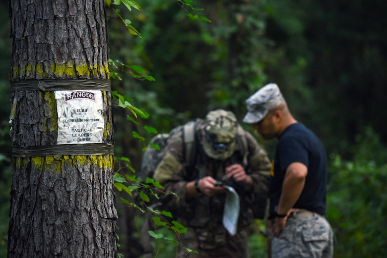 Senior Master Sgt. Dzajic Martinez, Pre-Ranger Assessment Course (Pre-RAC) instructor, right, reviews an Airmen's land navigation coordinates during a Pre-RAC, Aug. 25, 2018, at Moody Air Force Base, Ga. Moody's 93d Air Ground Operations Wing hosted the three-day assessment which challenged approximately 20 Airmen from the 93d AGOW and 23d Wing on their physical fitness, land navigation skills, leadership qualities, water confidence and academic and tactical abilities under duress. The evaluation is designed to determine whether Airmen are ready to attend the Air Force Ranger Assessment Course held at Fort Bliss, Texas. (U.S. Air Force photo by Senior Airman Greg Nash)