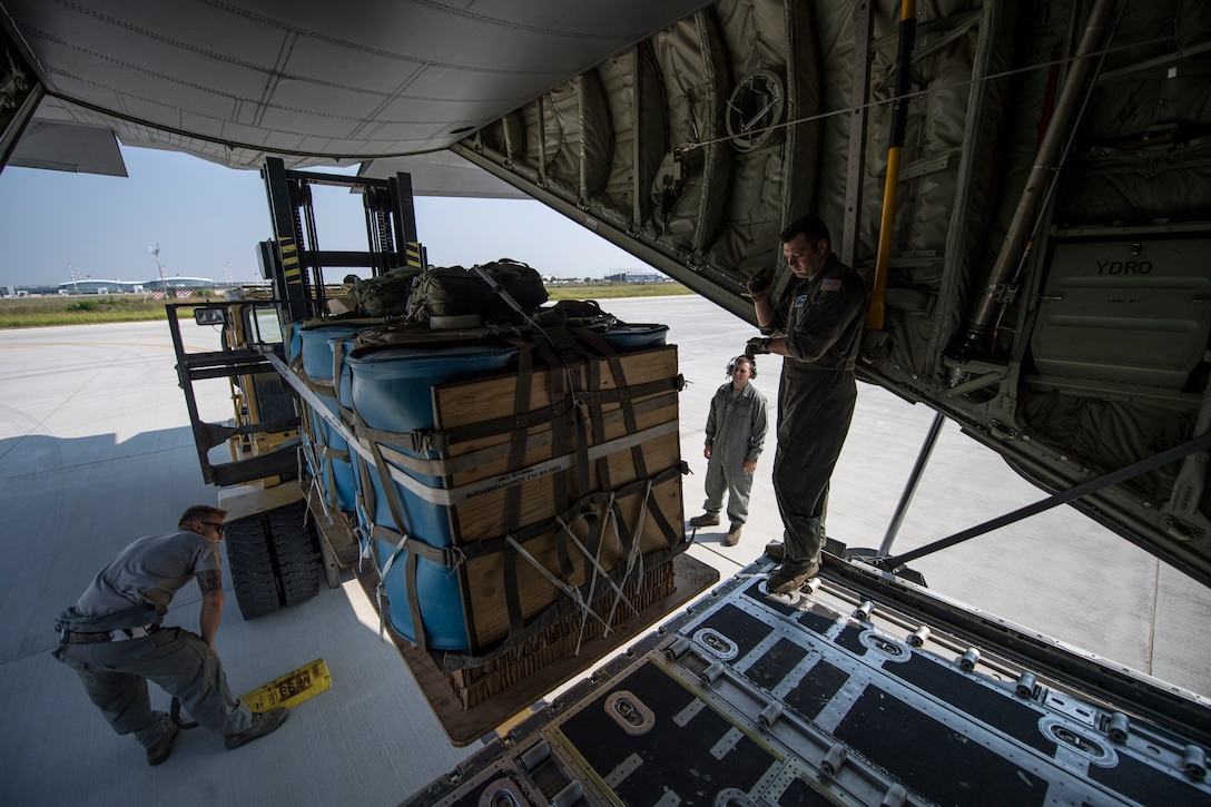 Romanian air force and U.S. Air Force personnel load container delivery system bundles onto a C-130J Super Hercules aircraft assigned to the 37th Airlift Squadron, Ramstein Air Base, Germany, as part of exercise Carpathian Summer 2018 at Otopeni Air Base, Romania, Aug. 22, 2018. Carpathian Summer is a bilateral training exercise designed to enhance interoperability and readiness of forces by conducting combined air operations with the Romanian air force. (U.S. Air Force photo by Senior Airman Devin Boyer)