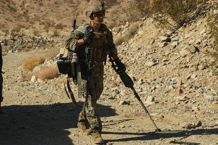 A U.S. Marine Corps Explosive Ordnance Disposal (EOD) student sweeps the response site with his Compact Metal Detector during Improvised Explosive Device training, which was conducted as part of the EOD Supervisors Course at Ranges 110 and 112 aboard the Marine Corps Air Ground Combat Center, Twentynine Palms, Calif. Aug. 17, 2018. The training was conducted with members of the U.S. Air Force for the purpose of helping members of the EOD community sharpen their skills as leaders for real life situations. (U.S. Marine Corps photo by Lance Cpl. Christian E. Moreno)