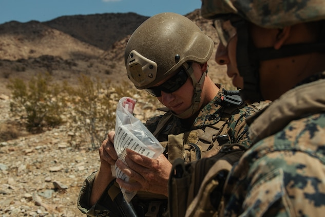A U.S. Marine Corps Explosive Ordinance Disposal (EOD) student examines samples of the Improvised Explosive Device (IED) his team found during IED training, which was conducted as part of the Supervise EOD Training at Range blah aboard the Marine Corps Air Ground Combat Center, Twentynine Palms, Calif. Aug. 17, 2018. The training was conducted with members of the U.S. Air Force for the purpose of helping members of the EOD community sharpen their skills as leaders for real life situations. (U.S. Marine Corps photo by Lance Cpl. Christian E. Moreno)