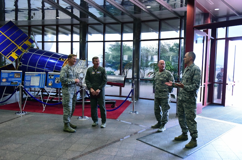 Gen. Tod D. Wolters, U.S. Air Forces in Europe and Air Forces Africa commander, second from left, is greeted by members of Team Buckley in the Mission Control Station lobby at Buckley Air Force Base, Colorado, Aug. 8, 2018.