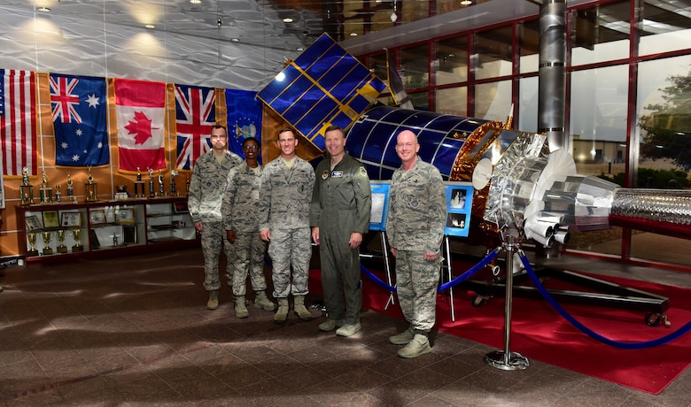 From left to right, Col. Robert Hutt, 460th Operations Group commander, Chief Master Sgt. Tamar Dennis, 460th Space Wing command chief, Maj. Micah Dodds, 11th Space Warning Squadron director of operations, Gen. Tod D. Wolters, U.S. Air Forces in Europe and Air Forces Africa commander, and Col. Troy L. Endicott, 460th SW commander, stand for a group photo in the Space Based Infrared System Mission Control Station lobby at Buckley Air Force Base, Colorado, Aug. 8, 2018.