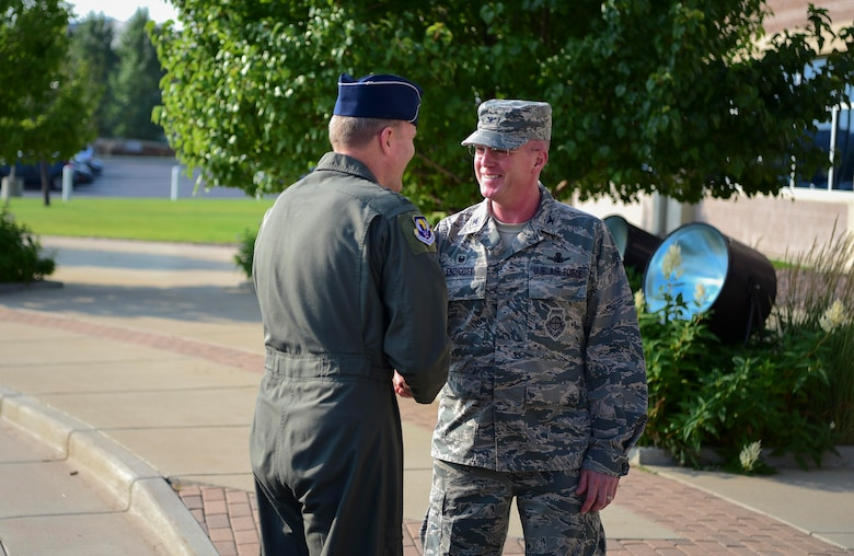 Col. Troy Endicott, 460th Space Wing commander, greets Gen. Tod D. Wolters, U.S. Air Forces in Europe and Air Forces Africa commander, Aug. 8, 2018, on Buckley Air Force Base, Colorado.