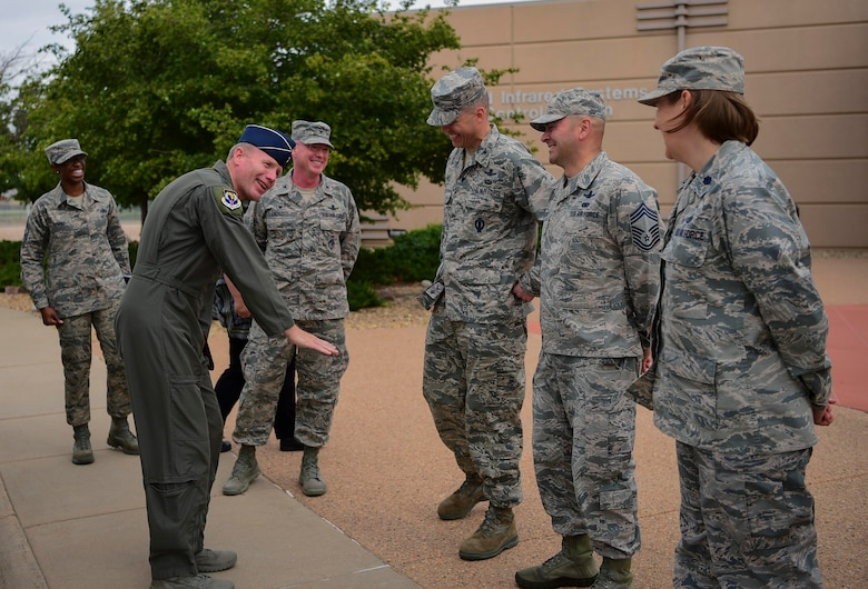 Gen. Tod D. Wolters, U.S. Air Forces in Europe and Air Forces Africa commander, jokes with Col. Robert Hutt, 460th Operations Group commander, during his visit Aug. 8, 2018, on Buckley Air Force Base, Colorado.