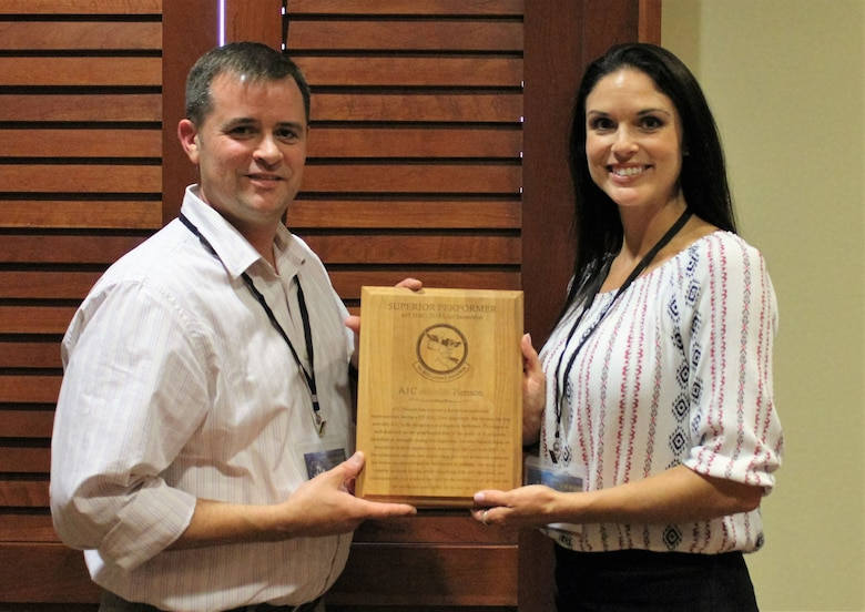 """655th Intelligence, Surveillance and Reconnaissance Group 14th Intelligence Squadron Commander Lt. Col. Ben Smallwood presents Senior Airman Henson with a """"Superior Performer"""" award at a leadership conference in San Antonio, Texas, July 25, 2018."""