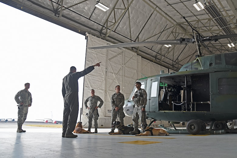 The 36th Rescue Squadron spent numerous hours throughout the month of August teaching 92nd Security Forces Squadron Military Working Dog handlers how to load and unload their dogs, how to safely fly with a canine and basic egress training in case of an emergency while flying in a huey. The importance of deployment training for handlers and MWDs is crucial to the success of the team and the unit with which they deploy with. (U.S. Air Force photo/Staff Sgt. Mackenzie Mendez)