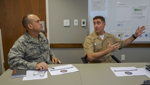 Air Force Brig. Gen. Edward L. Vaughan, head of the Air Force Unexplained Physiological Events Integration Team (UPE IT) and Rear Adm. Fredrick R. Luchtman, Navy Physiological Episodes Action Team (PEAT) lead, discuss ongoing efforts to minimize the risk of Physiological Episodes (PEs). The Navy and Air Force relationship enables the development of joint solutions to achieve a better understanding of the cockpit environment and oxygen systems to keep our aircrews safe. (U.S. Navy photo by Cmdr. Scot Cregan/Released