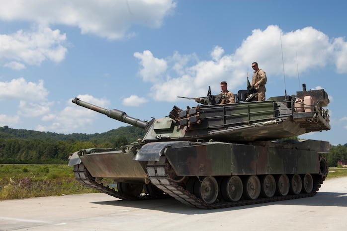 A crew of Marines from 1st Tank Battalion position the M1A1 Abrams tank for the 15th annual Tiger Competition ceremony at Wilcox range, Fort Knox, Kentucky, Aug. 28, 2018. The competition highlights the critical and quick-reacting combat skills of the participating battalions. (U.S. Marine Corps photo by Lance Cpl. Tessa D. Watts)