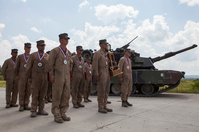Marine tank gunner crews from 1st, 2nd, and 4th Tank Battalions stand in formation during the 15th annual Tiger Competition ceremony at Wilcox range, Fort Knox, Kentucky, Aug. 28, 2018. The crew from 2nd Tank Bn. was recognized as the competition winner. (U.S. Marine Corps photo by Lance Cpl. Tessa D. Watts)