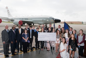 Representatives from U.S. Department of Defense, Nebraska and educational organizations pose for a photo August 28, 2018 inside an aircraft hangar at Offutt AFB, Nebraska with Advanced Placement students from Bellevue Public Schools following the presentation of a check by the DoD representing the award of $1.3 million to the Bellevue Public Schools STEM program. The award is part of the National Math and Science Initiative that promotes STEM education in more than 200 U.S. schools that have significant enrollment among military-connected students. (U.S. Air Force photo by Delanie Stafford)