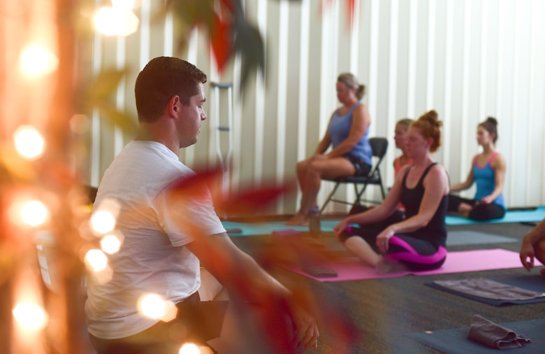 U.S. Air Force Master Sgt. Ramiro Villalobos, Paul W. Airey Noncommissioned Officer Academy instructor, meditates at the beginning of a Tyndall Pacesetters yoga class at the Balfour Beatty Community Center on Tyndall Air Force Base, Florida, Aug. 22, 2018. Regular yoga sessions can produce a number of benefits like lessening chronic pain, such as lower back pain, arthritis, headaches and carpal tunnel syndrome. (U.S. Air Force photo by Senior Airman Cody R. Miller)