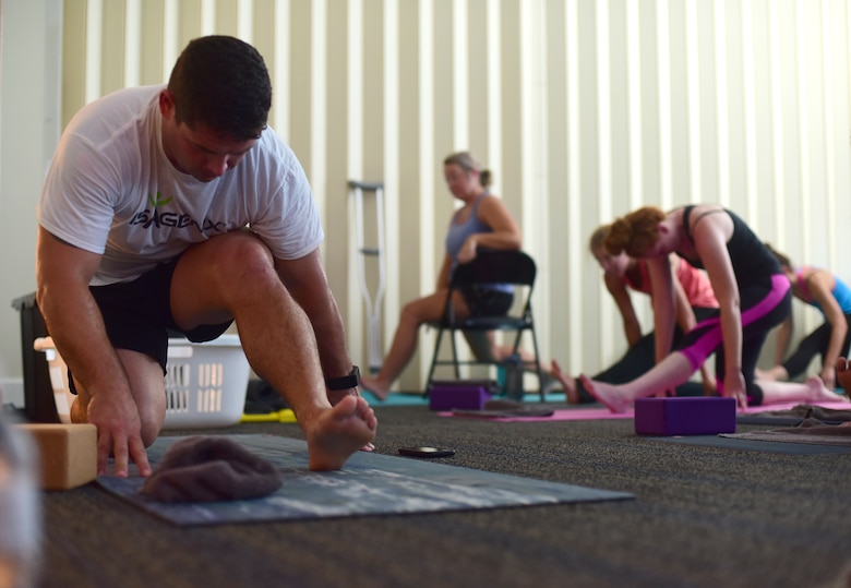 U.S. Air Force Master Sgt. Ramiro Villalobos, Paul W. Airey Noncommissioned Officer Academy instructor, teaches a class at a Tyndall Pacesetters yoga session at the Balfour Beatty Community Center on Tyndall Air Force Base, Florida, Aug. 22, 2018. Villalobos teaches yoga for the group with the goal of providing a positive atmosphere of self-betterment through high-intensity training, yoga and run training. (U.S. Air Force photo by Senior Airman Cody R. Miller)