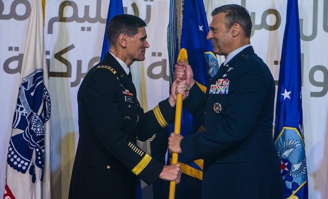 U.S. Army Gen. Joseph L. Votel, Commander of U.S. Central Command (CENTCOM), passes the guidon to U.S. Air Force Lt. Gen. Joseph T. Guastella Jr., Commander of U.S. Air Forces Central Command (AFCENT), during a change of command ceremony at Al Udeid Air Base, Qatar, Aug. 30, 2018. As the Combined Force Air Component Commander for CENTCOM, Guastella is responsible for developing contingency plans and conducting air operations in a 20-nation area of responsibility covering Central and Southwest Asia. AFCENT, in concert with coalition, joint, and interagency partners, delivers decisive air, space and cyberspace capabilities for CENTCOM, allied nations, and America. (U.S. Air Force photo by Senior Airman Xavier Navarro)