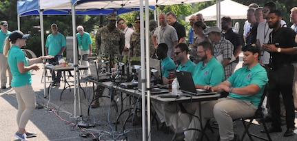 IMAGE: DAHLGREN (Aug. 7, 2018) – Kim Wendt – a Naval Surface Warfare Center Dahlgren Division (NSWCDD) software engineer – briefs military personnel and senior scientists and engineers about the Sly Fox Mission 23 demonstration known as the Autonomous Remote Tactical Engagement Multi-Domain Intelligence Swarm (ARTEMIS). Wendt was among seven junior scientists and engineers (less than two years out of college) who developed ARTEMIS to engage in enhanced ISR missions using unmanned ground vehicles (UGVs), artificial intelligence, and machine learning to detect targets efficiently and effectively. While the use of UGVs met the requirements set forth by Mission 23, the team envisions a more complex system that expands to the aerial domain.