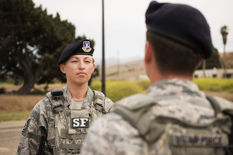 Tech. Sgt. April Spilde, flight chief for the 30th Security Forces Squadron, inspects her Airmen as they offer her a post briefing August 2, 2018, on Vandenberg Air Force Base. Airmen report their post when leadership visits and it helps in maintaining discipline and military bearing. (U.S. Air Force photo by Airman 1st Class Hanah Abercrombie)