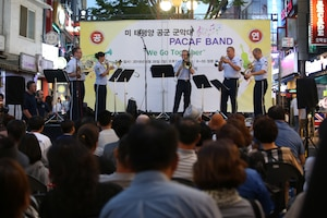 Pacific Brass from the Pacific Air Forces Band at Yokota Air Base, Tokyo, Japan, plays an arrangement during the Seventh Air Force Friendship Concert right outside Osan Air Base, Republic of Korea, Aug. 26. More than 150 people attended the hour-long concert aimed at building stronger friendships with local community partners and residents. (U.S. Air Force photo by Master Sgt. Nadine Barclay)