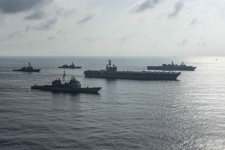 SOUTH CHINA SEA (Aug. 31, 2018) The Ronald Reagan Strike Group ship's aircraft carrier USS Ronald Reagan (CVN 76), the guided-missile destroyer USS Antietam (CG 54) and the guided-missile destroyer USS Milius (DDG 69) conduct a photo exercise with the Japanese Maritime Self-Defense Force ship's the helicopter destroyer JS Kaga (DDH 184), the destroyer JS Inazuma (DD 105) and the destroyer JS Suzutsuki (DD 117). The Ronald Reagan Strike Group is forward-deployed to the U.S. 7th Fleet area of operations in support of security and stability in the Indo-Pacific region.