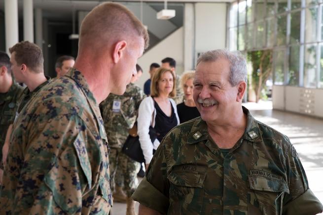 Brazilian Naval Infantry Rear Adm. Nelio de Almeida speaks to U.S. Marine Col. Kevin Jarrard