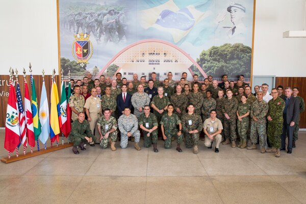 Service members from 10 countries pose for a photo