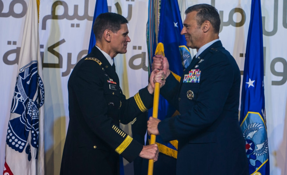 Army Gen. Joseph L. Votel, U.S. Central Command commander, passes the guidon to  Air Force Lt. Gen. Joseph T. Guastella Jr., U.S. Air Forces Central Command commander, during a change of command ceremony at Al Udeid Air Base, Qatar, Aug. 30, 2018. As CENTCOM's Combined Force Air Component commander, Guastella is responsible for developing contingency plans and conducting air operations in a 20-nation area of responsibility covering Central and Southwest Asia. AFCENT, in concert with coalition, joint, and interagency partners, delivers decisive air, space and cyberspace capabilities for CENTCOM, allied nations, and the U.S. (U.S. Air Force photo by Senior Airman Xavier Navarro)
