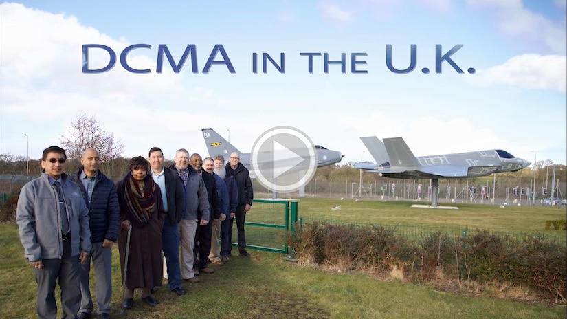 Group of people pose in front of F-35 aircraft.