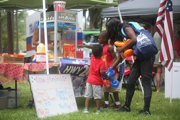 Attendants visit a booth during a military appreciation day on Laurel Bay, Aug. 25. The booth was sponsored by Highway 21 Drive-In movie theater.