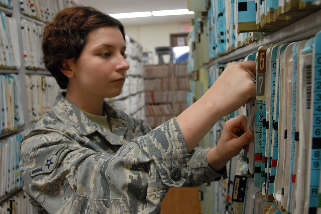 Oregon Air National Guard Airman Alexa Ferris conducts a quality check on patient records in the Outpatient Records section at Tripler Army Medical Center, in Honolulu, Hawaii, Aug. 28, 2018. Ferris and her fellow Airmen from the 142nd Medical Group took part in Medical Facilities Annual Training, Aug. 18-31, 2018, and were able to assist in a real-world support mission when Hurricane Lane threatened to strike the Hawaiian Islands the week of Aug. 20, 2018. (U.S. Air National Guard Photo by Master Sgt. Nick Choy)