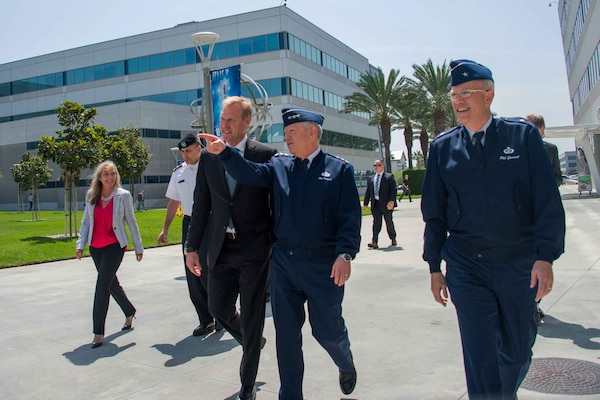 Deputy Defense Secretary Patrick Shanahan walks with Lt. Gen. John F. Thompson, commander of the Space and Missile Systems Center, Brig. Gen. Philip Garrant, SMC vice commander, Joy White, SMC executive director, during a tour of Los Angeles Air Force Base in El Segundo, Calif., Aug 27, 2018. Air Force photo by Van De Ha