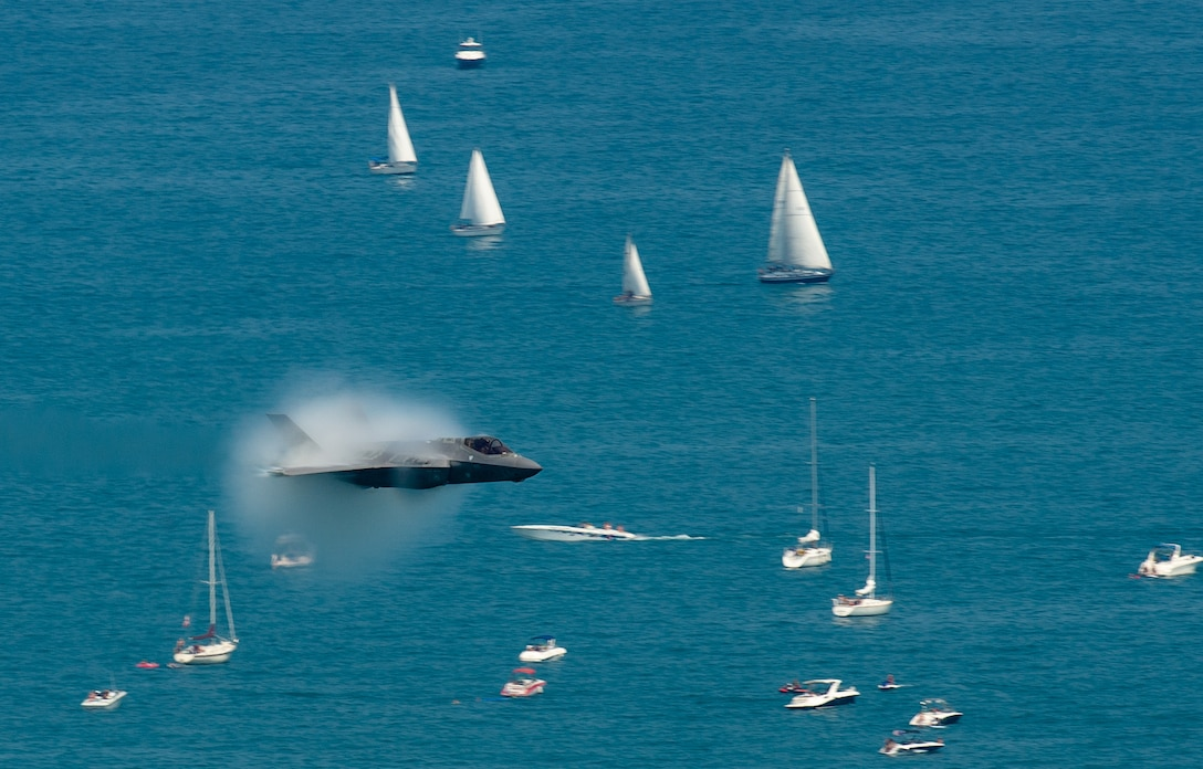 """Capt. Andrew """"Dojo"""" Olson, F-35 Heritage Flight Team pilot and commander, performs a high speed pass in an F-35A Lightning II over Lake Michigan during the Chicago Air and Water Show in Chicago, Aug. 19, 2018. The F-35A Lightning II is equipped with the largest single engine motor ever built and is capable of reaching speeds of up to 1,200 miles per hour. (U.S. Air Force photo by Airman 1st Class Alexander Cook)"""