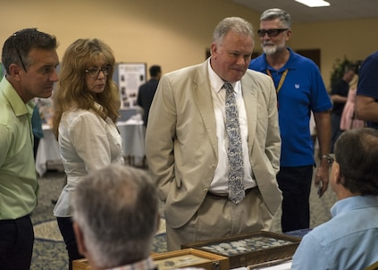 PANAMA CITY, Florida - Naval Surface Warfare Center Panama City Division Technical Director Ed Stewart (SES) and base personnel receive information about cultural artifacts at the 2018 Diversity Day event aboard Naval Support Activity Panama City Aug. 29, 2018. U.S. Navy photo by Eddie Green