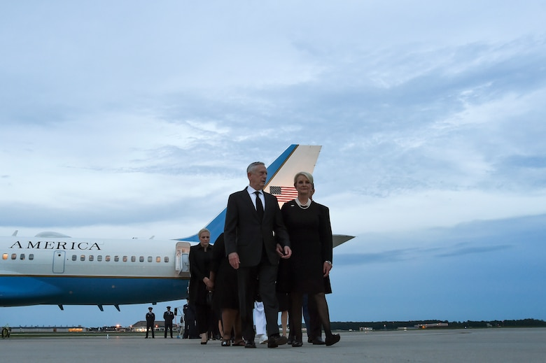 U.S. Secretary of Defense James N. Mattis walks with Cindy McCain, wife of Senator John McCain after greeting her at the steps of an 89th Airlift Wing C-32 aircraft upon arrival at Joint Base Andrews, Md., Aug. 30, 2018. The aircraft arrived with the remains of McCain and his family. (U.S. Air Force photo by Staff Sgt. Kenny Holston)