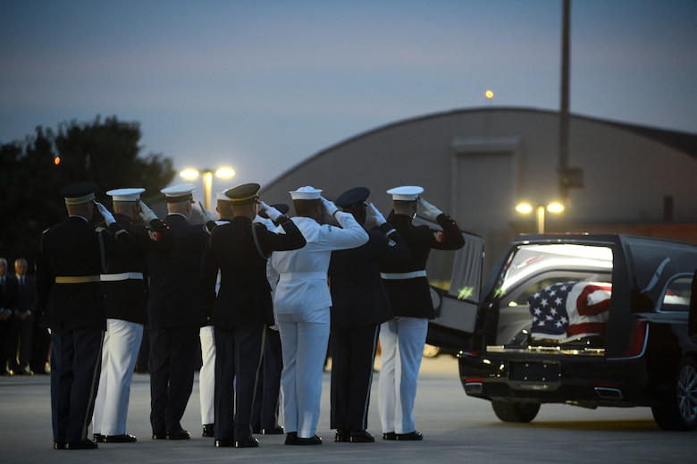 Members of the Joint Service Arrival Team render a final salute after transferring the casket of Sen. John McCain from an 89th Airlift Wing C-32 aircraft to a hearse at Joint Base Andrews, Md., Aug. 30, 2018. (U.S. Air Force photo by Staff Sgt. Kenny Holston)